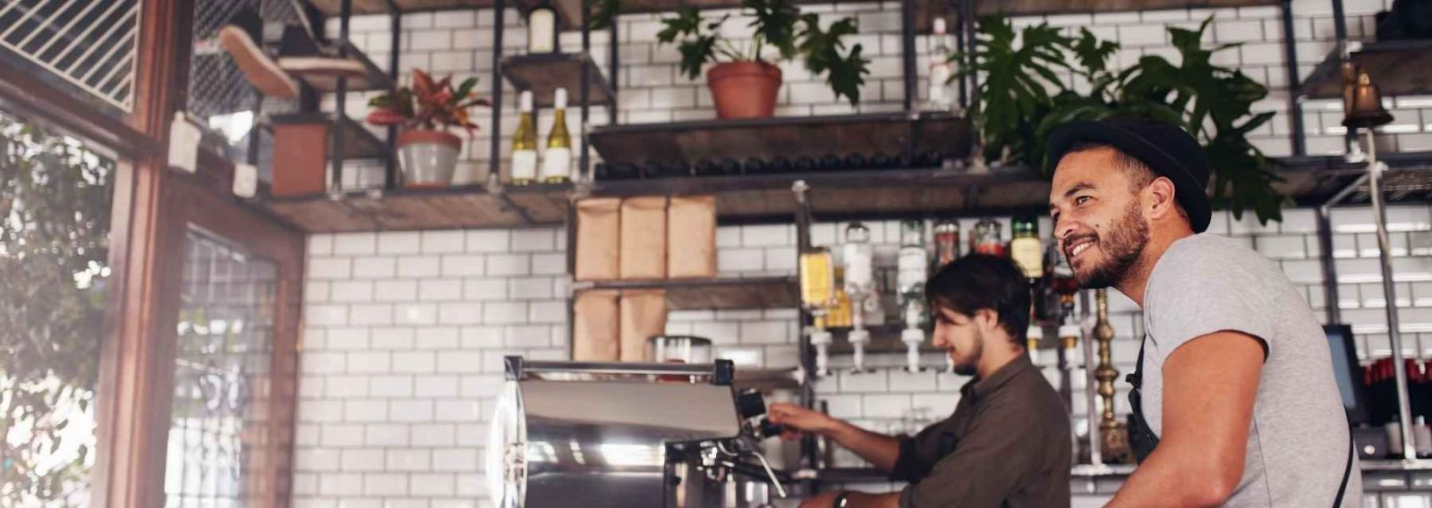 two men working behind the counter at a bar
